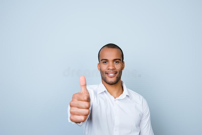 Successful young handsome mulatto american guy banker in formal stock images