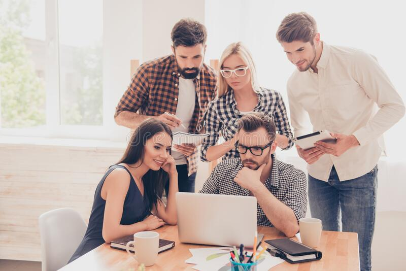 Successful young people at a meeting make a business plan.  stock photos