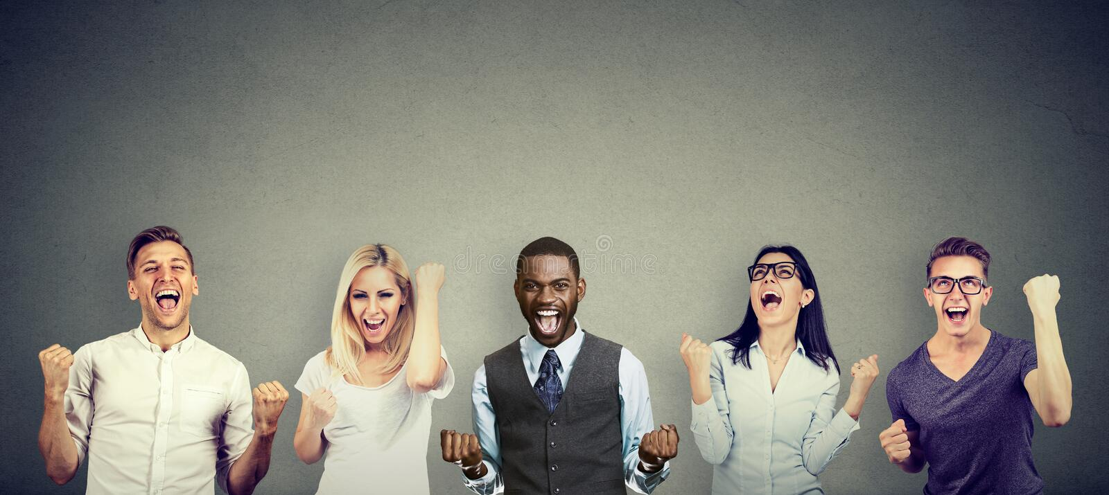 Successful young people men and women are celebrating a victory stock image