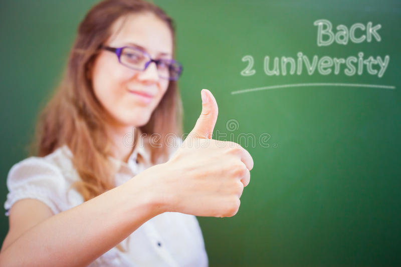 Successful young teacher or student at university or school classroom royalty free stock image