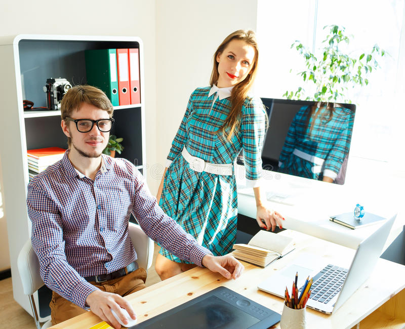 Successful young woman and man working from home. Successful young women and men working from home - modern business concept royalty free stock photography