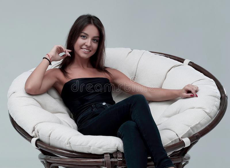 Young woman sitting in comfortable round big chair royalty free stock photos