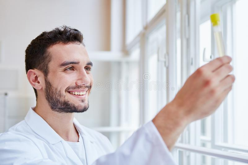 Successfull scientist makes experiment. Analysis at lab royalty free stock images