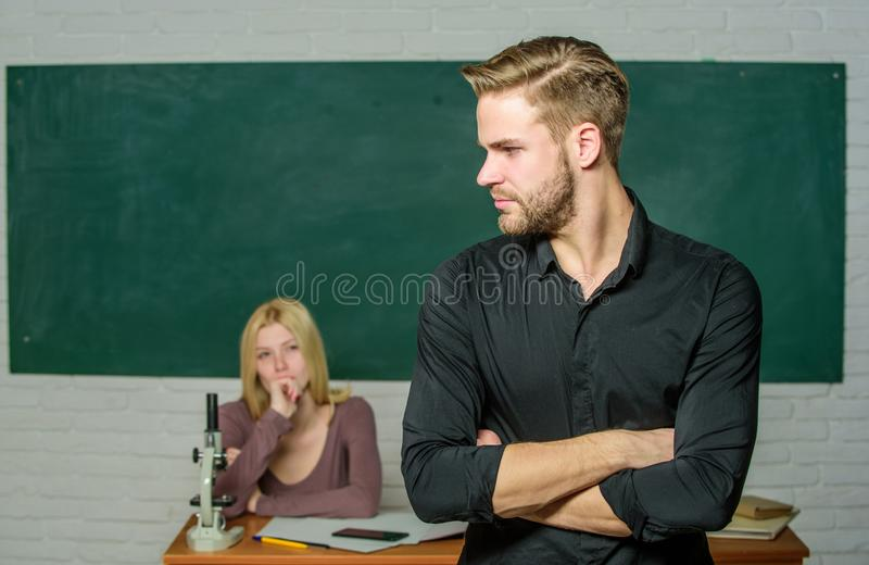 Successfully graduated. Youth mentoring. Man well groomed attractive teacher in front of classroom. Obsessed with. Knowledge. Teacher of her dreams. Handsome stock photo