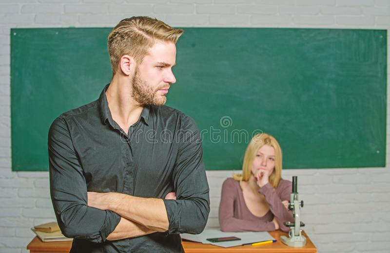 Successfully graduated. Youth mentoring. Man well groomed attractive teacher in front of classroom. Obsessed with. Knowledge. Teacher of her dreams. Handsome stock image