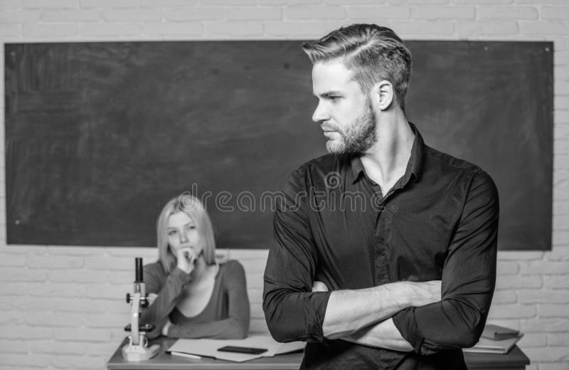 Successfully graduated. Youth mentoring. Man well groomed attractive teacher in front of classroom. Obsessed with. Knowledge. Teacher of her dreams. Handsome royalty free stock photography