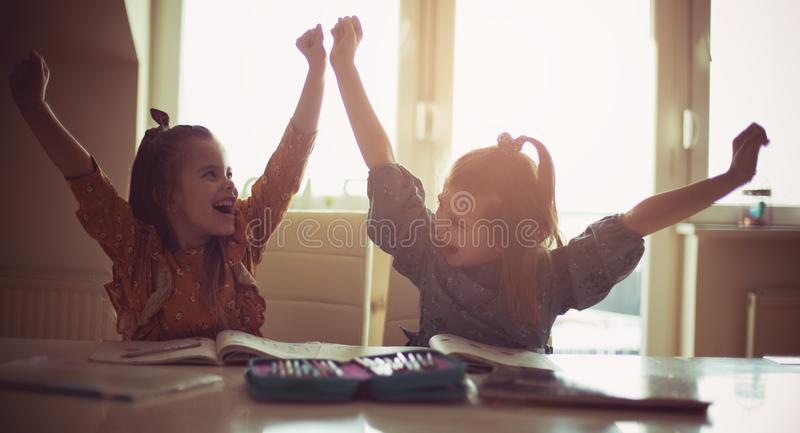 Successfully students. Two little girls working homework at home. Space for copy royalty free stock image