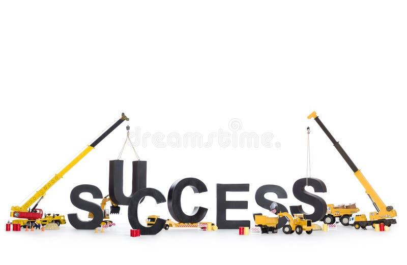 Successo di accumulazione: Macchine che sviluppano successo-parola. fotografie stock libere da diritti