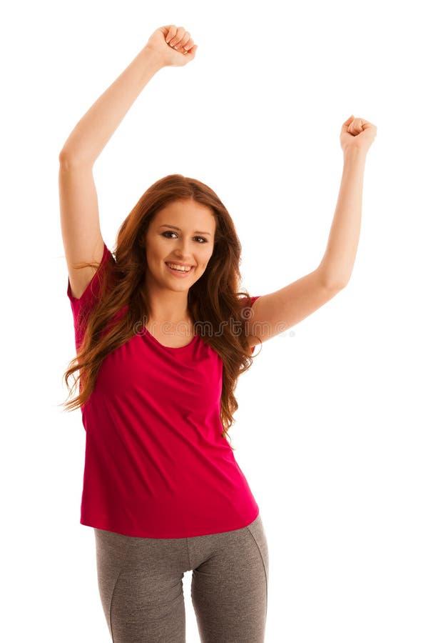 Successo - donna che gesturing vittoria con le sue mani sollevate nella a fotografia stock libera da diritti