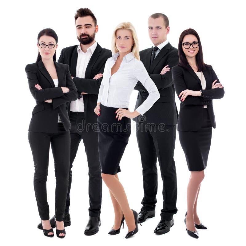 Succesvol team - jonge bedrijfsmensen in zwarte die kostuums op wit worden geïsoleerd stock foto's