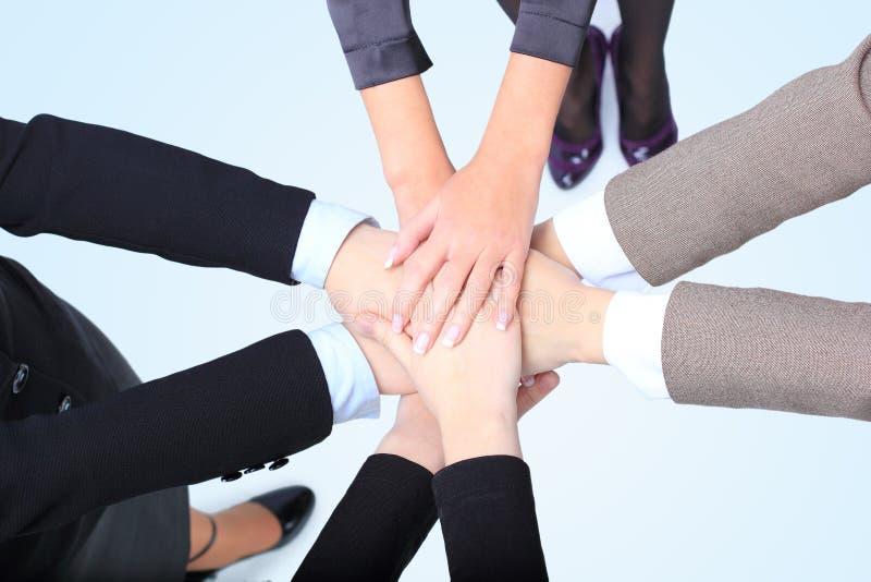 Succesvolle bedrijfsvrouwen met hun handen stock afbeelding