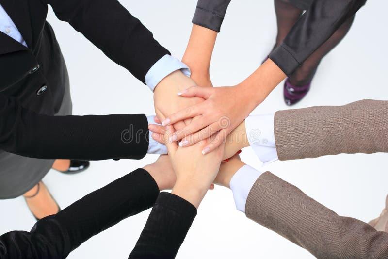 Succesvolle bedrijfsvrouwen met hun handen stock afbeeldingen