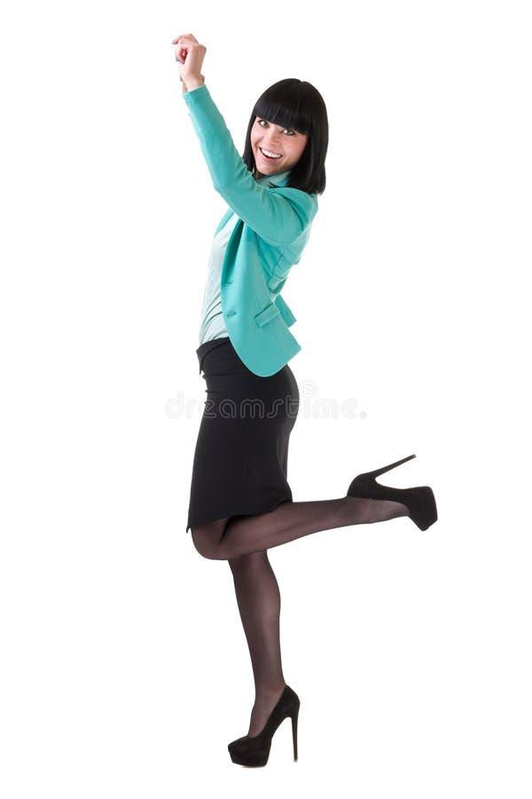Succesvolle jonge bedrijfsvrouw gelukkig voor haar succes het springen Geïsoleerd volledig lichaamsbeeld op witte achtergrond stock fotografie