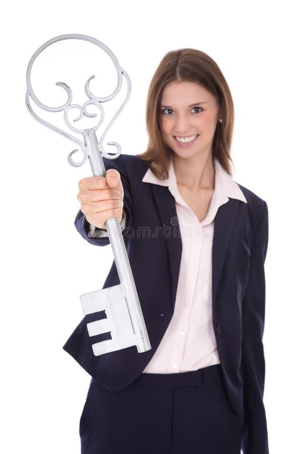 Succesvolle jonge onderneemster die een sleutel houdt: concept voor succes royalty-vrije stock foto