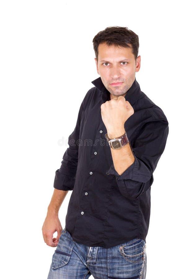 Succesvolle mens in de zwarte vuist van de overhemdsholding omhoog royalty-vrije stock afbeelding