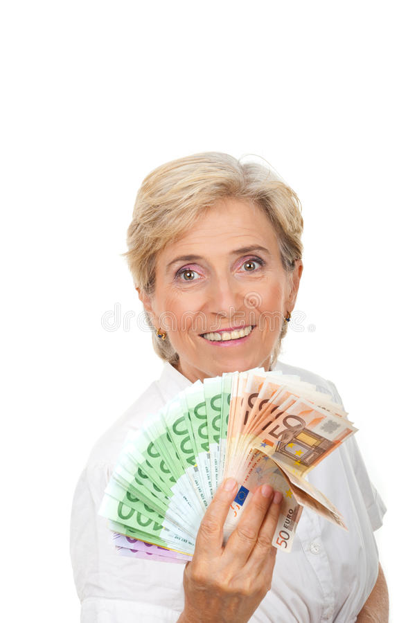 Succesvolle oudste met handvol van geld stock afbeeldingen