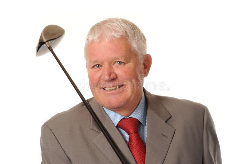 Succesvolle rijpe zakenman met golfclub royalty-vrije stock afbeelding