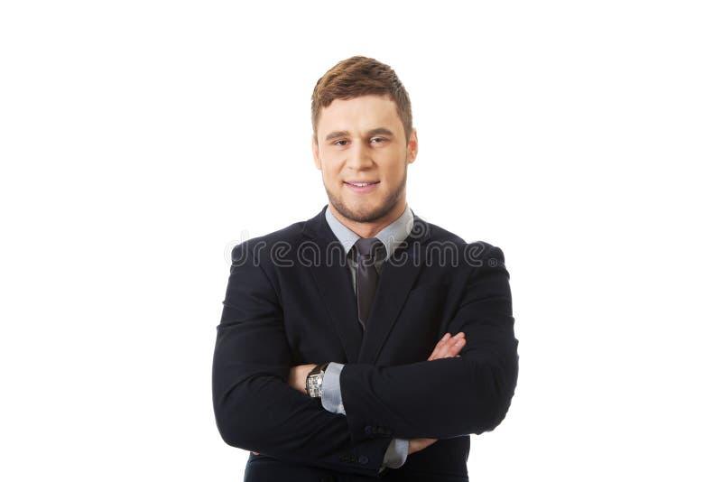 Succesvolle zakenman met gevouwen wapens royalty-vrije stock foto