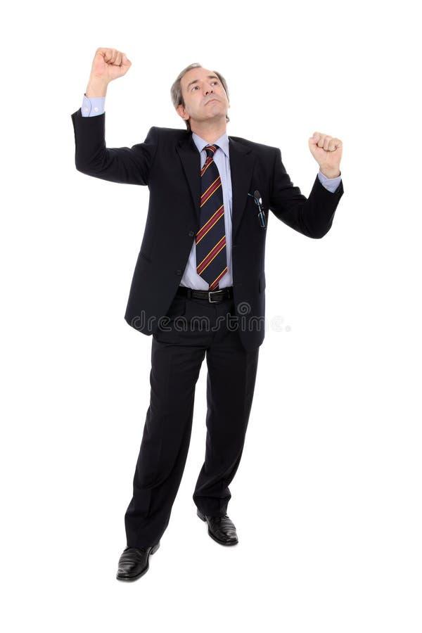 Succesvolle zakenman met omhoog wapens stock foto's