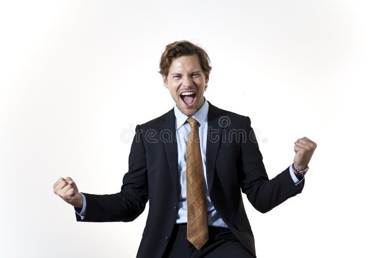 Succesvolle zakenman in ogenblik van overwinning royalty-vrije stock fotografie