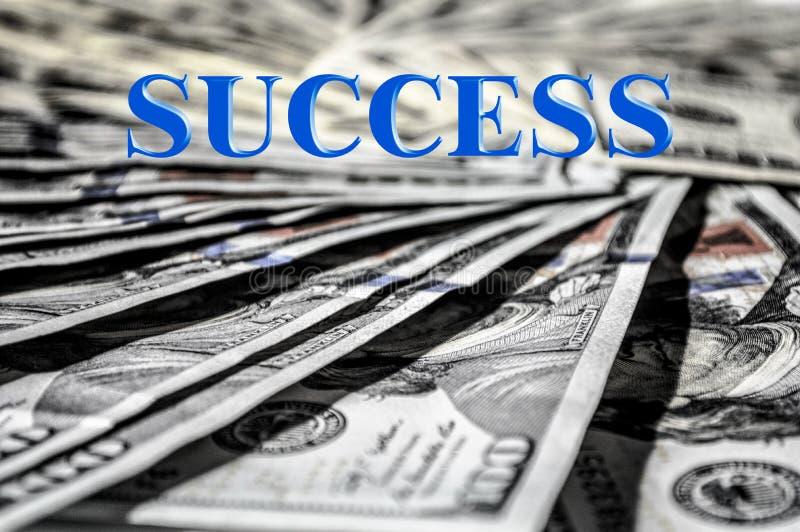 Succeswoord en USD-Geldmuntachtergrond stock foto's