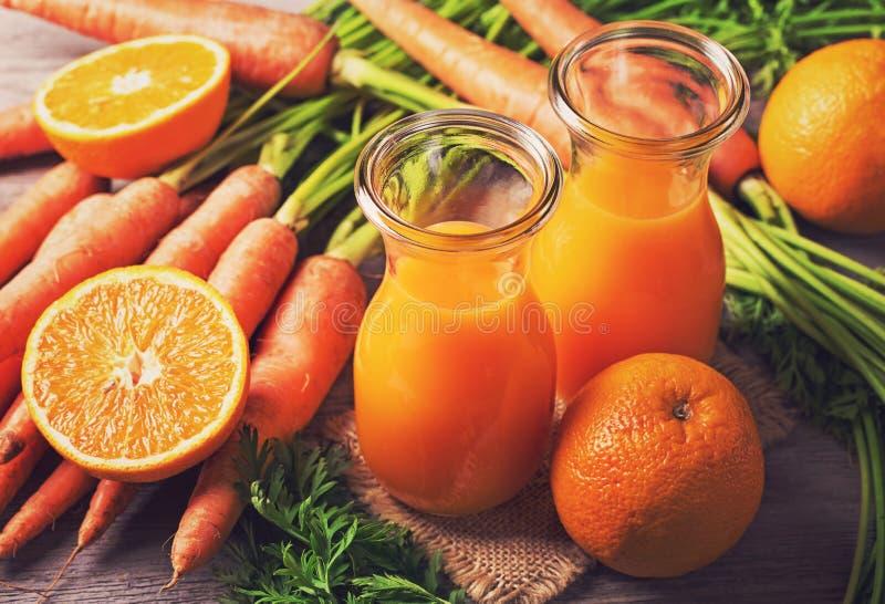 Succo d'arancia della carota immagini stock libere da diritti