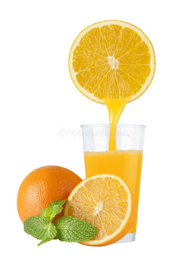 Succo d'arancia in vetro immagine stock