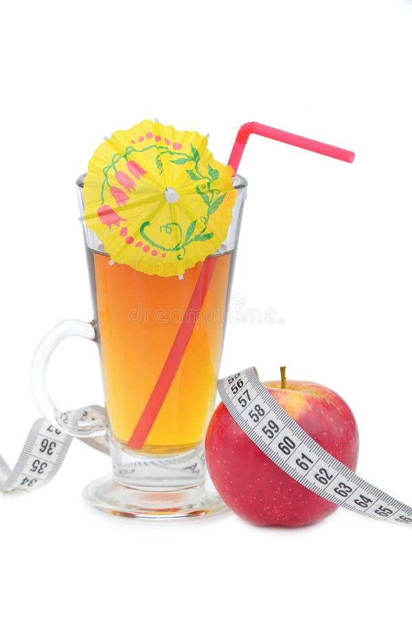 Succo di mele e mela fotografia stock