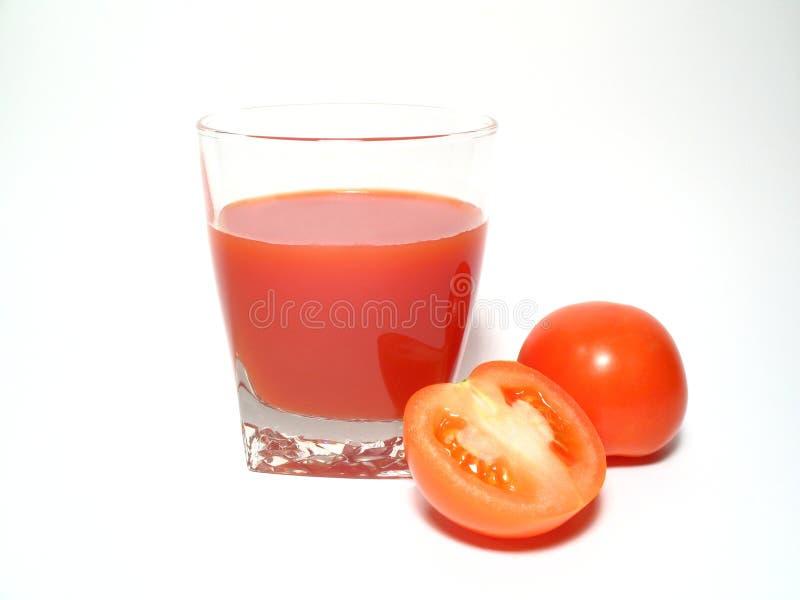 Succo di pomodori fotografia stock libera da diritti