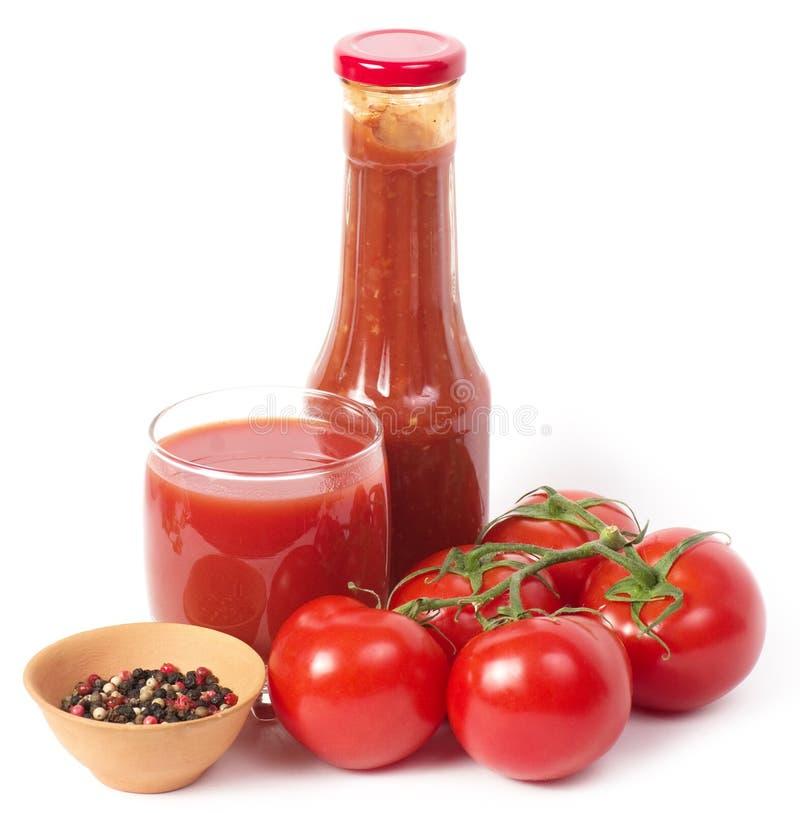 Succo e salsa di pomodoro freschi fotografie stock