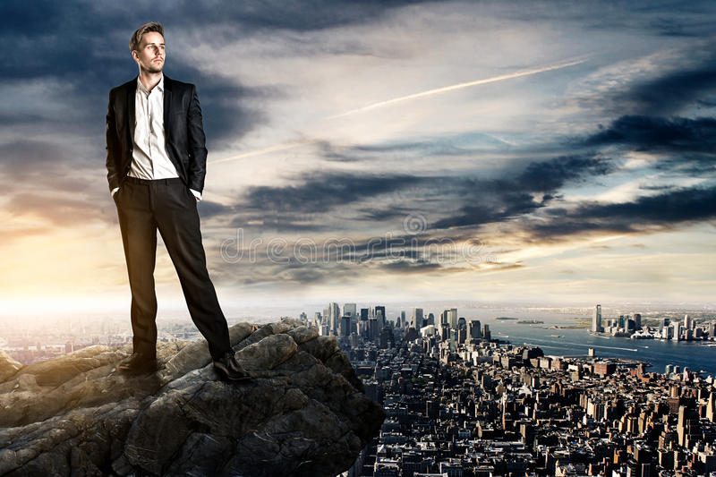Sucess. Ful Business man on a rock royalty free stock images