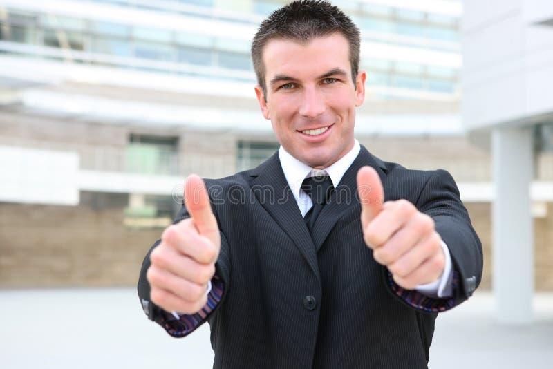 Sucesso da sinalização do homem de negócio imagem de stock royalty free