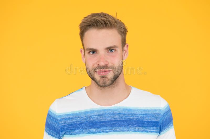 Such a handsome guy. Handsome man on yellow background. Caucasian male model with unshaven handsome face and stylish royalty free stock photography