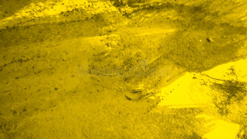 Suchy koloru proszek na powierzchni Textured cyfrowy papier Żółty farby pluśnięcie na tle obrazy stock