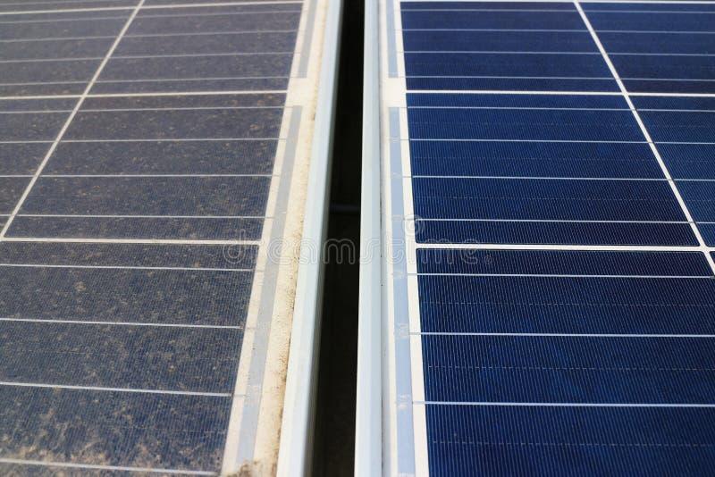Sucio contra los paneles fotovoltaicos limpios imágenes de archivo libres de regalías