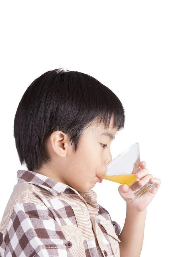 Suco bebendo do menino imagens de stock