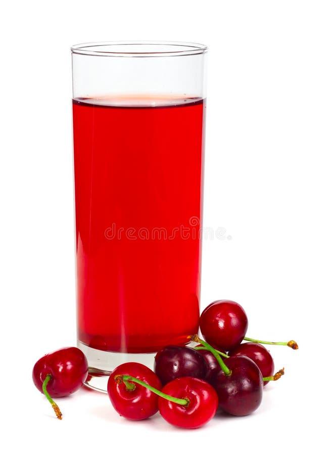 Suco com diversas cerejas fotografia de stock