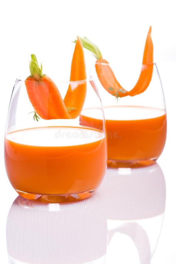 Suco de cenoura imagem de stock