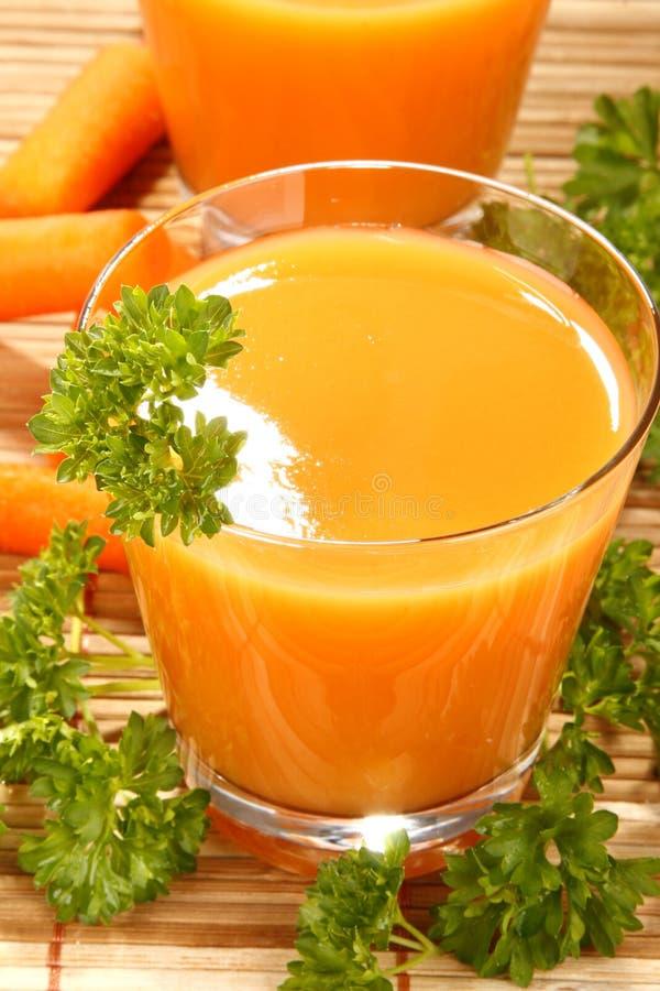 Suco de cenoura imagens de stock