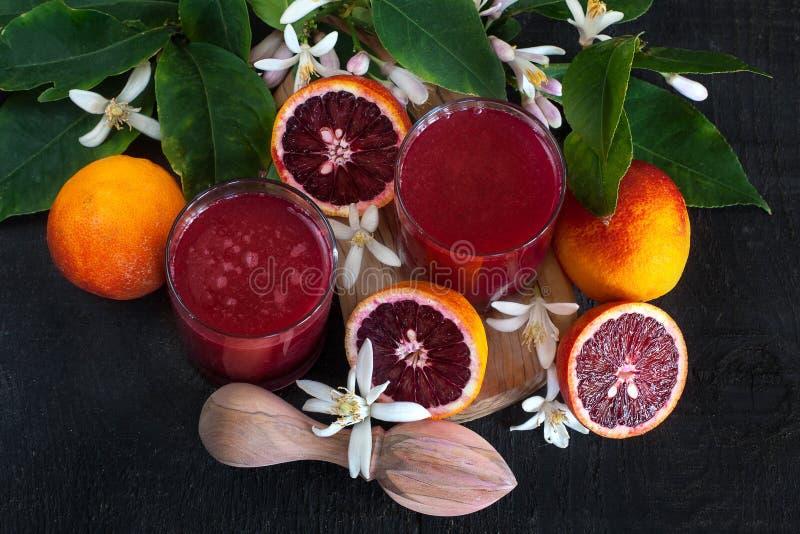 Suco de laranja do sangue fotografia de stock