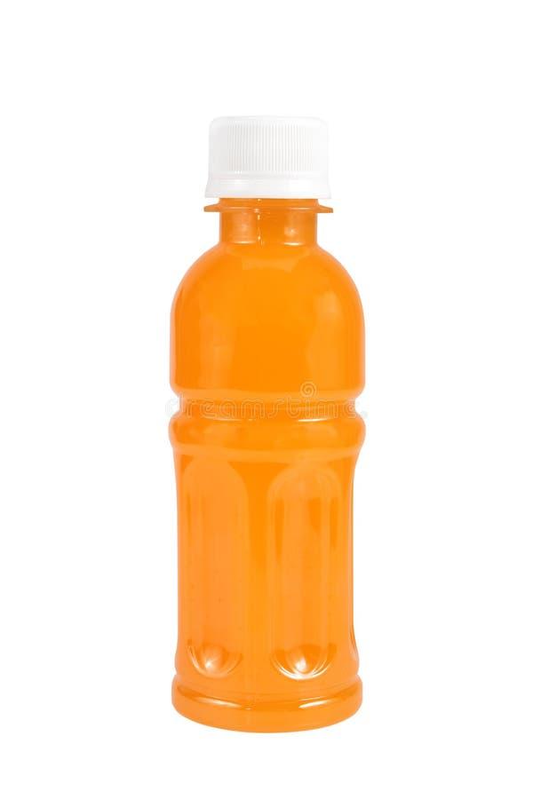 Suco de laranja em uma garrafa isolada no branco fotografia de stock royalty free