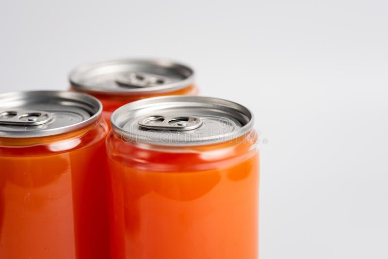 Suco de laranja em uma lata diáfano foto de stock royalty free