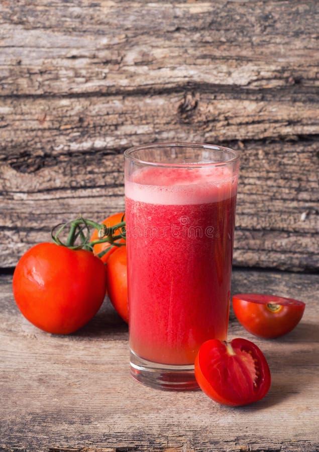 Suco de tomates imagem de stock royalty free