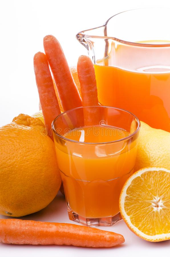 Suco do citrino e de cenoura fotografia de stock royalty free
