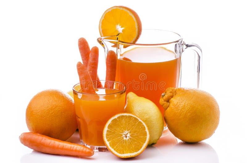 Suco do citrino e de cenoura imagem de stock