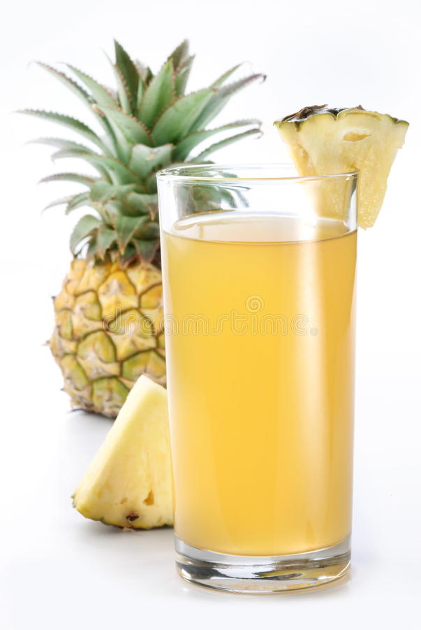 Suco e fruta de abacaxi. imagem de stock royalty free