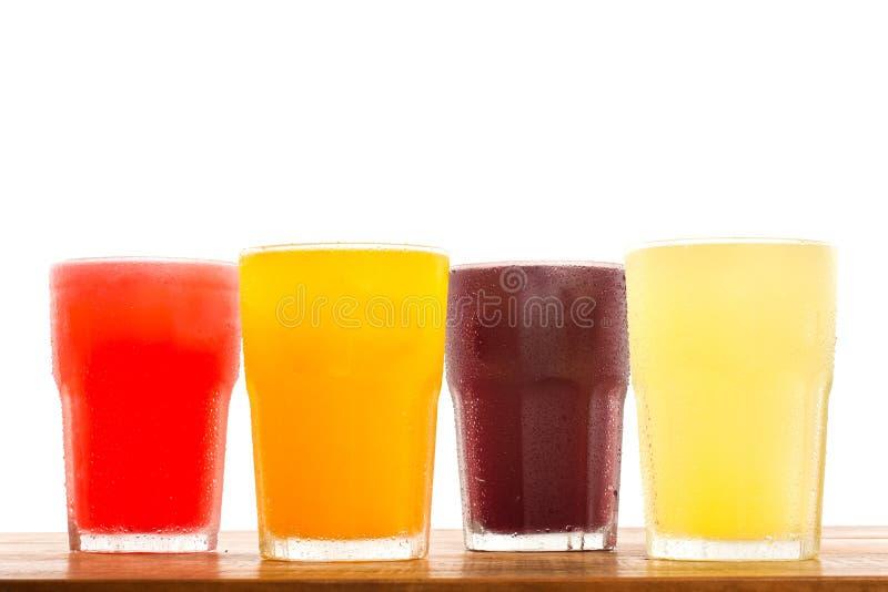 Sucos frescos coloridos imagem de stock