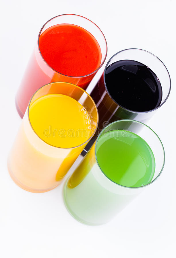 Sucos frescos isolados no branco fotos de stock