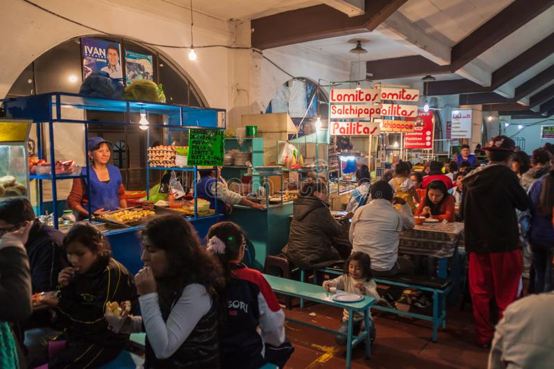 SUCRE, BOLIVIA - APRIL 21, 2015: Local people sit at the eateries at the market in Sucre, Boliv stock photography