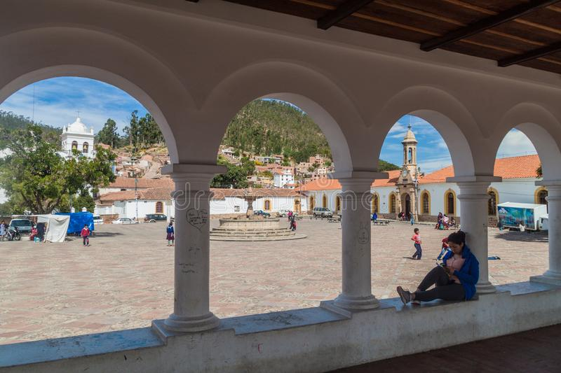 SUCRE, BOLIVIA - APRIL 22, 2015: White colonial houses and an archway on Plaza Anzures square in Sucre, capital of. Bolivia royalty free stock photos